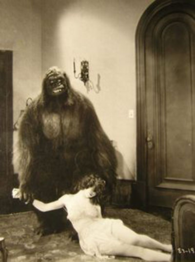 Gorilla suited figure drags woman